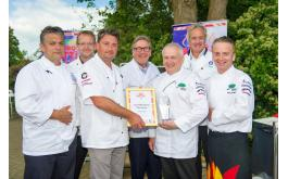 Image of BBQ champion Graham Crump with Ray Hall and judges