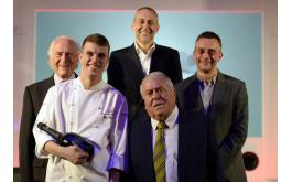 Image of 2014 Roux scholar Tom Barnes and the Roux family
